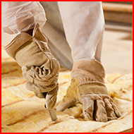 Person Cutting Insulation